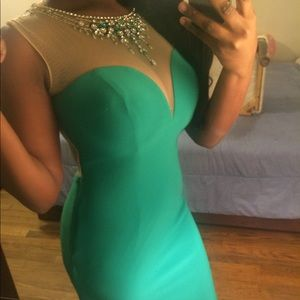 Emerald green prom dress with matching earrings